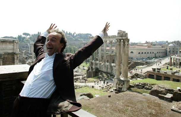 "Italian actor and director Roberto Benigni poses in front of the Roman Forum, 04 April 2007 in Rome. Oscar-winner Benigni will recite ""TuttoDante"" (Everything About Dante), an one-man comic rendition of the medieval Italian epic poem, at the Teatro Tenda, piazza Clodio, in Rome, 20 April 2007. AFP PHOTO / TIZIANA FABI (Photo credit should read TIZIANA FABI/AFP/Getty Images)"